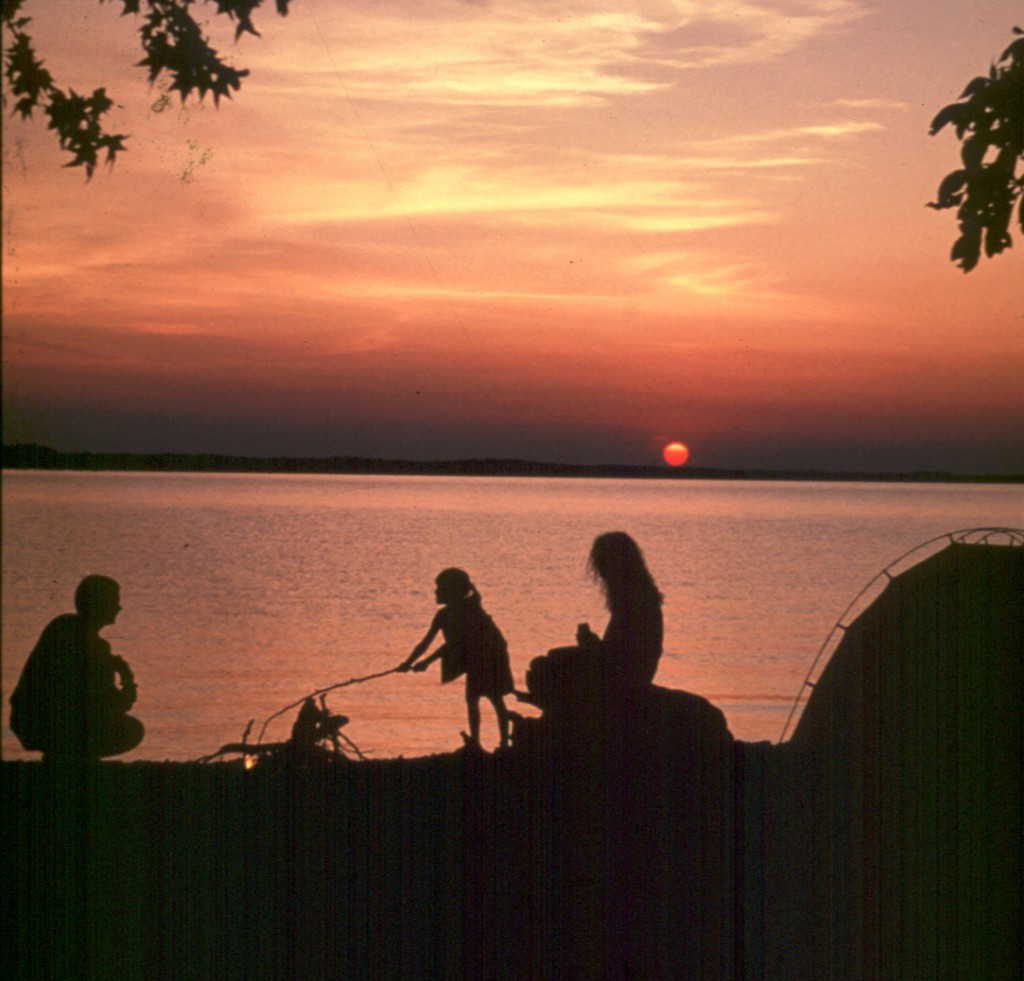 Family camping on the water's edge