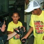 Nature Station staff introducing a black rat snake