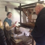 Homeplace 1850s Farm Interpreter talking about the loom. Staff photo