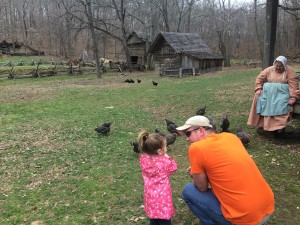 Daddy daughter time with the chickens and ducks at the Homeplace 1850s Working Farm.