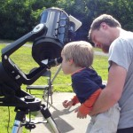 Child viewing through a telescope at Golden Pond Planetarium and Observatory