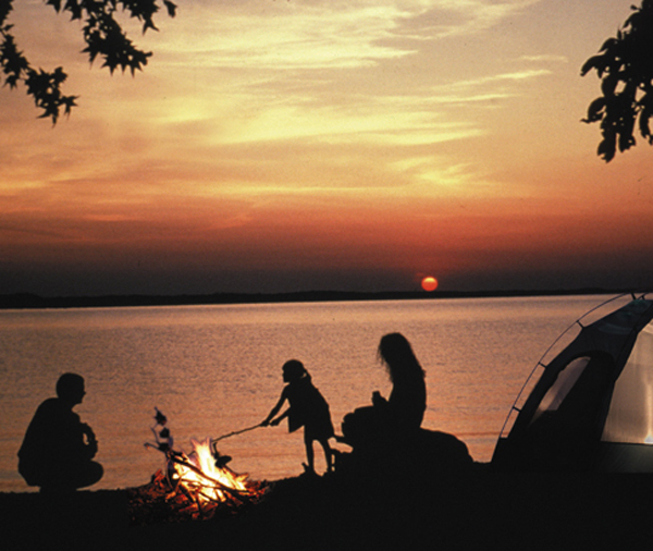 Family camping at sunset