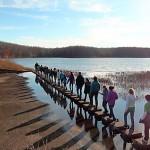 Group walking across Hematite stepping stones