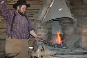 Working the bellows at the Homeplace 1850s Farm, Photo by Brian Truskey