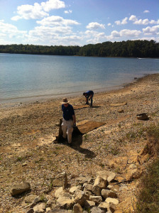 Volunteers pick up trash along Pisgah Bay shore line in 2015, Photo by Emily Cleaver, Volunteer Coordinator