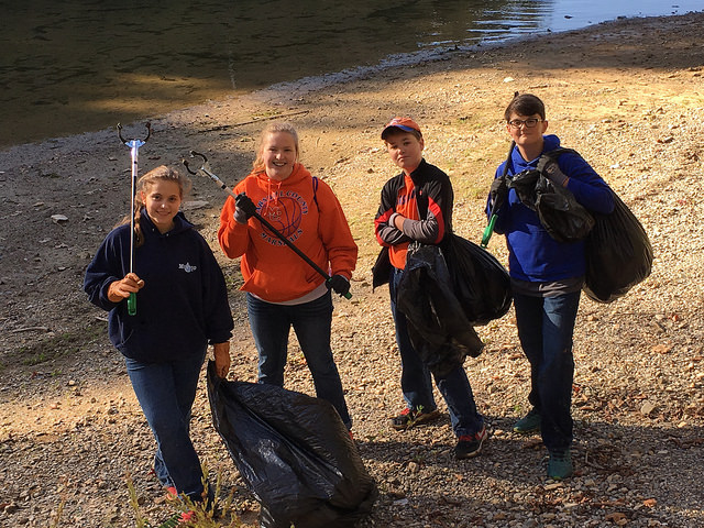 Marshall County Middle School students volunteer on a shoreline cleanup at Twin Lakes. Photo by Emily Cleaver