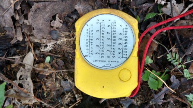 A Clinometer is used to measure the height of trees and percent slope of the ground. Photo by Yvonne Helton